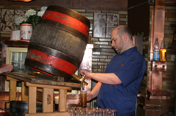 Pouring beer from the barrel