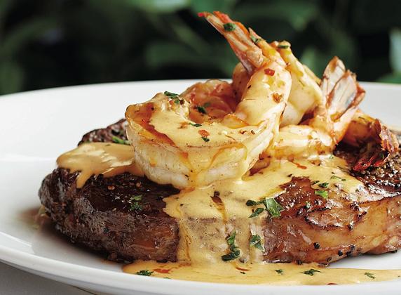 Prime steak topped with diablo shrimp