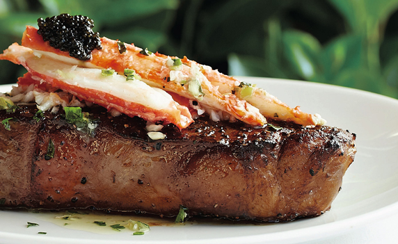 Prime steak with king crab and herb butter simmered with fresh herbs and garlic and topped with caviar.