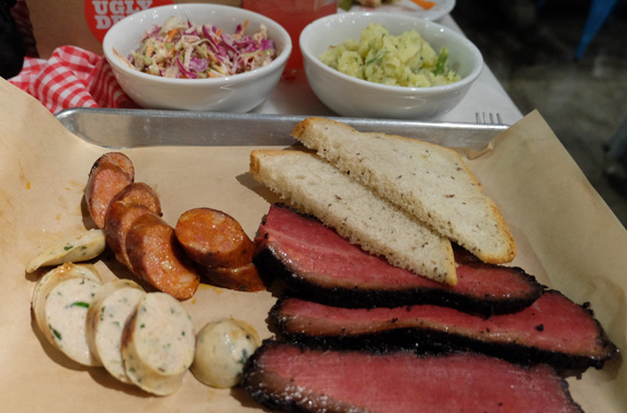 Certified angus brisket pastrami smoked 12 hours in pecan, Thai chile sausage, Texas hot links, apple slaw and potato salad