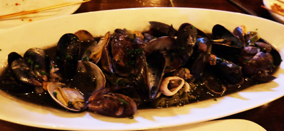 Squid ink pasta had lots of seafood (clams, mussels, shrimp) mixed with fettuccine noodles