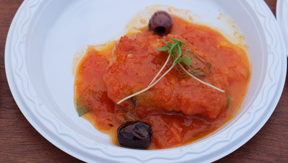 Fresh monkfish served with a sauce consisting of tomatoes, olives and basil