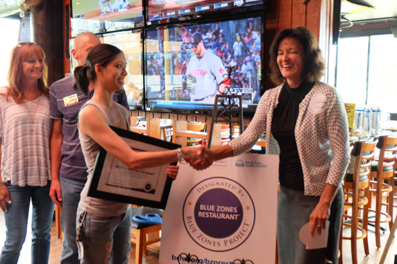 Blue Zones project director, Lauren Nakano congratulates assistant manager Vanessa Swartz