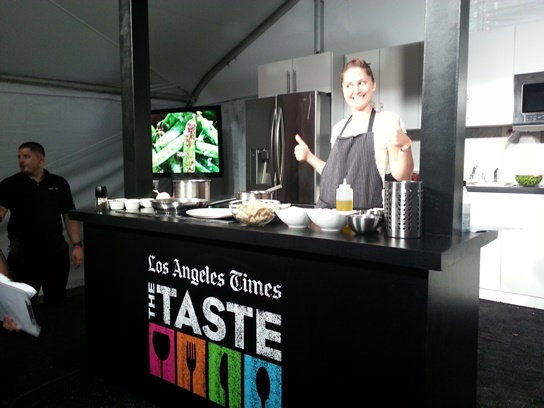 Chef Brook Williamson gives two thumbs up during a cooking demo at the 2013 LA Times The Taste.