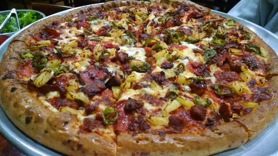"Aloha's Pizza sport Hawaiian names like Kamehameha  and ""Da Pele"".  Pele comes with Pepperoni, Portuguese sausage, bacon, jalapenos, and pineapple."