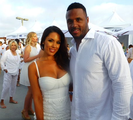 Fashion model Carissa Rosario, left, and James Anderson of the Dallas Cowboys.