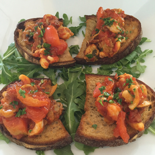 Crisp crostini topped with an assortment of fresh clams, mussels, shrimp and calamari