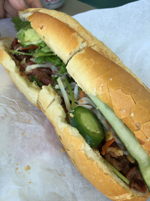 Charbroiled beef banh mi sandwich
