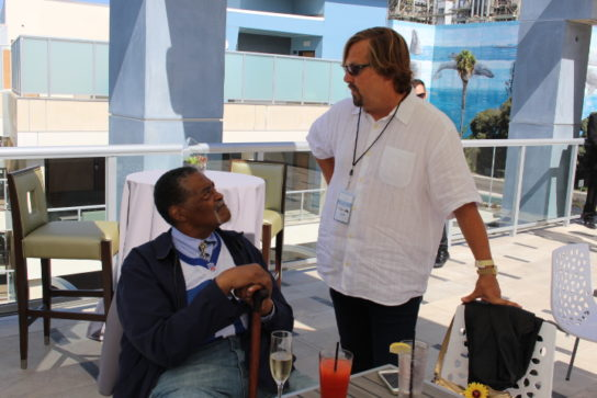 Rams legend Rosey Grier and hotel owner Michael ZIslis share a moment during the party.