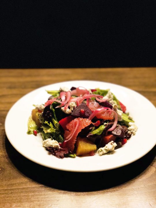 The salad alone is worth the trip with roasted winter beets, herbed goat cheese, pink grapefruit and pickled red onions with a balsamic rosemary pomegranate vinaigrette.