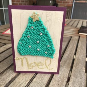 A knitted christmas tree card