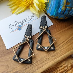 black trapezoid dangly earrings with large diamond charm