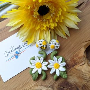 Large Daisy dangly earrings on a swirly green stalk and a daisy covered stud