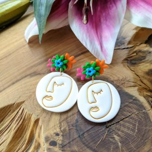 Abstract Frida Kahlo style dangly earrings. Flower studs with white abstract face with gold powder ink outline