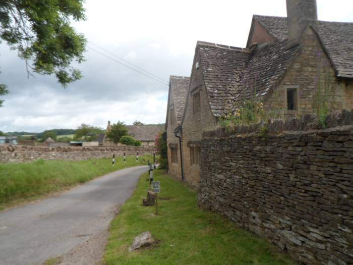 After crossing fields we come into a village