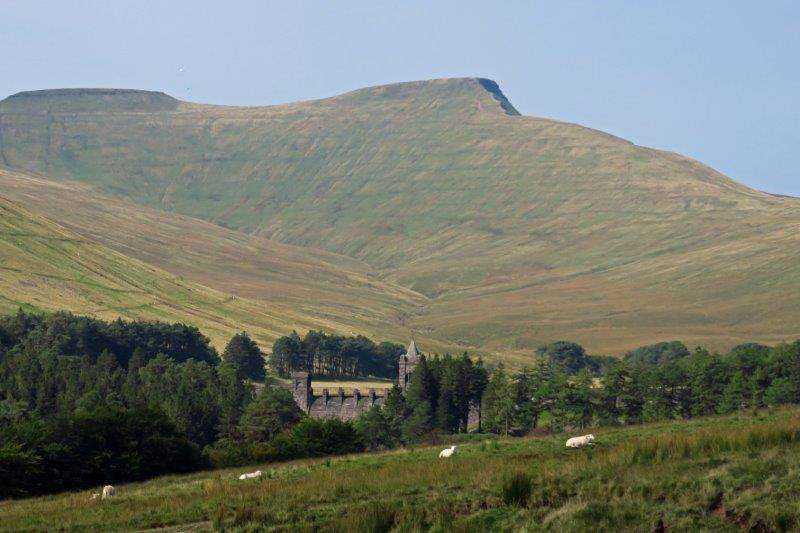 And we look back at a dam with the Beacons behind