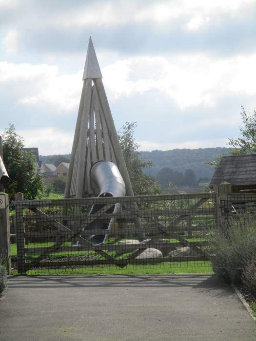 We pass an interesting adventure playground feature, which a young member of our group samples