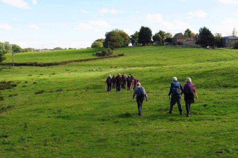 Then head back across fields to the start of our walk