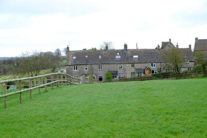 Old terraced cottages across the field