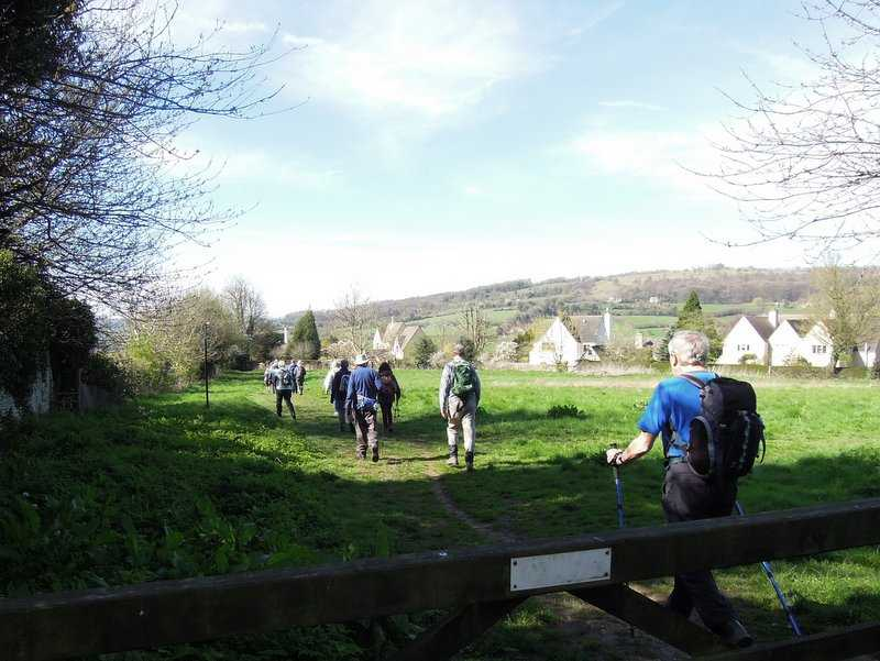 "We head through ""Tony Drake's field"" on the Cotswold Way"