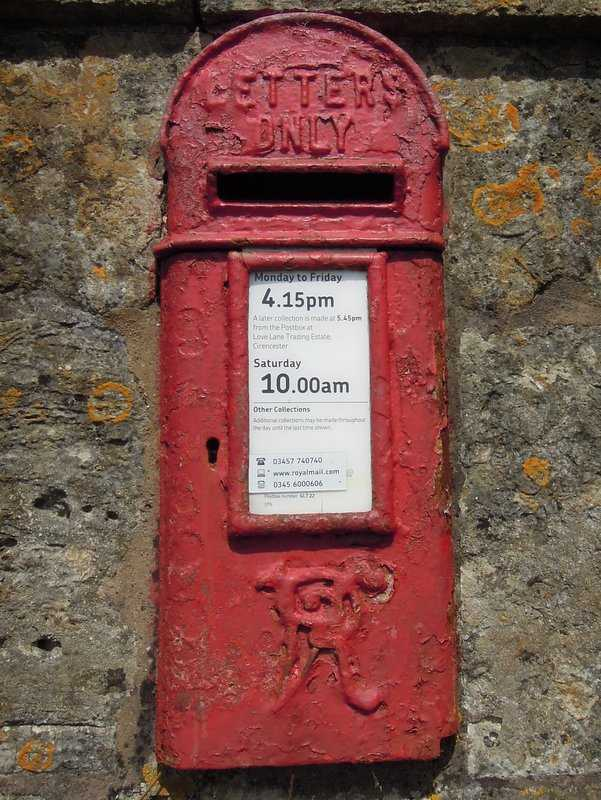 We climb up past Duntisbourne House with its Victorian postbox