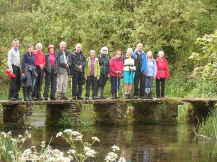 We pose on the clapper bridge over the River Leach, like thousands of tourists before us.