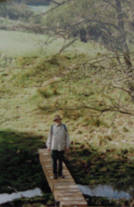 Fuzzy picture from 1995 - New footbridge and stile in distance - erected after Group's request. Les Woollerton, group footpath sec at the time. Before picture ....
