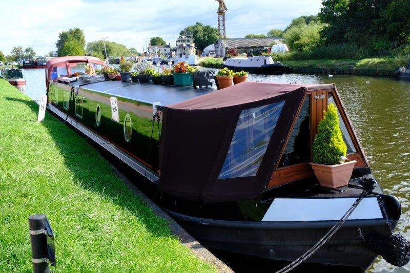 We head off along the canal passing many colourful boats