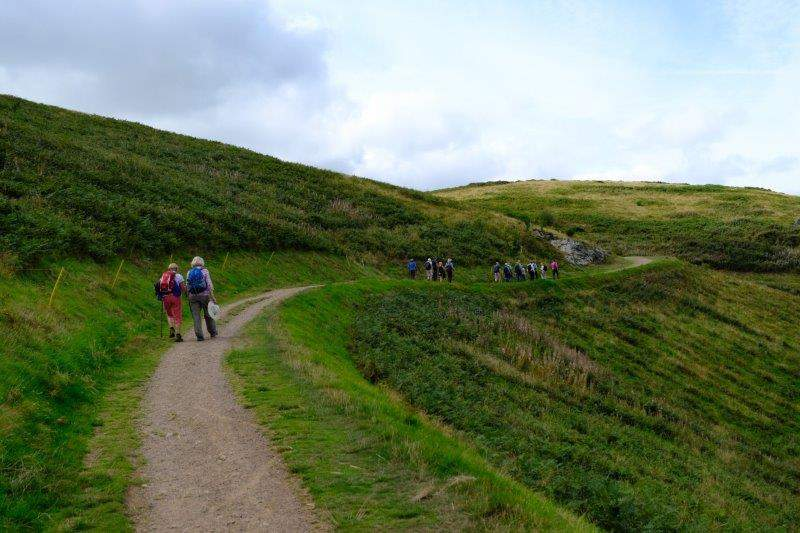 As we follow the path round the hill