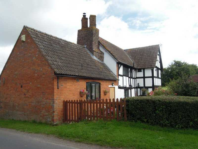 We meet near the half timbered house