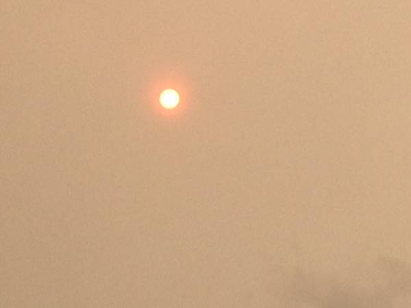 Red sun phenomenon casts a ghostly haze