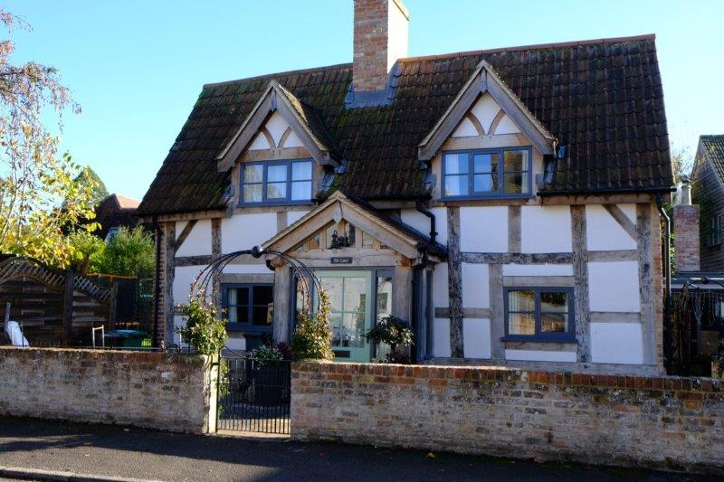 With its timbered cottages