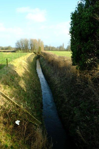 Before continuing on our way, crossing a drainage ditch