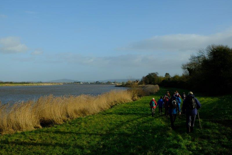 Still following the river bank