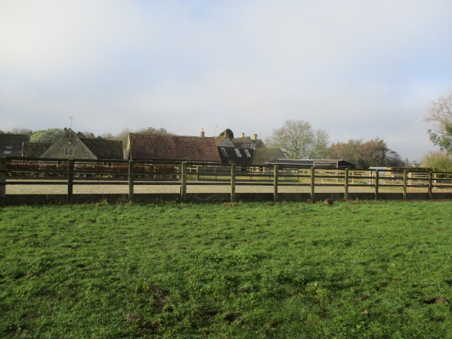 Past a farm with a manege