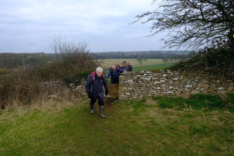 Off we go again over an old stone slab stile