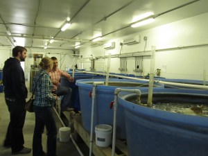 Marc Turano explains the aquaculture system to visitors. Photo by Andrew David Thaler