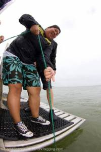 A participant helps us pull in a drumline, the fishing gear we use to catch sharks