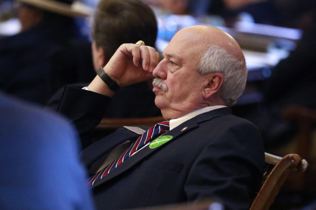 Jan. 28, 2016 -  Atlanta - Rep. Tommy Benton, R - Jefferson, watches proceedings from his desk on the floor of the House.   BOB ANDRES  / BANDRES@AJC.COM