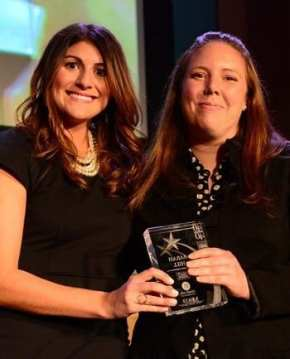 Mia Pilato presents the 40 Under 40 Award to Sarah Hill Photo Credit: Byron E. Small, Atlanta Business Chronicle