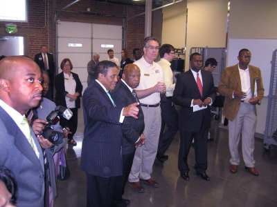Congressman John Lewis and Mayor Kasim Reed stand with Dennis Creech at the opening of the SWEET Center.