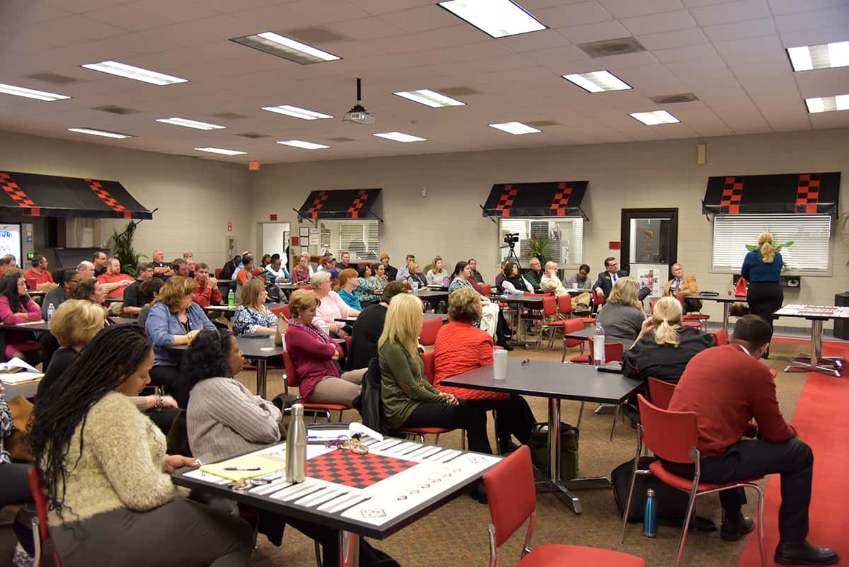 A room full of SGTC employees listen to a presentation about Behavioral Intervention from Jen Ziifle of the Technical College System of Georgia during a recent staff development day.