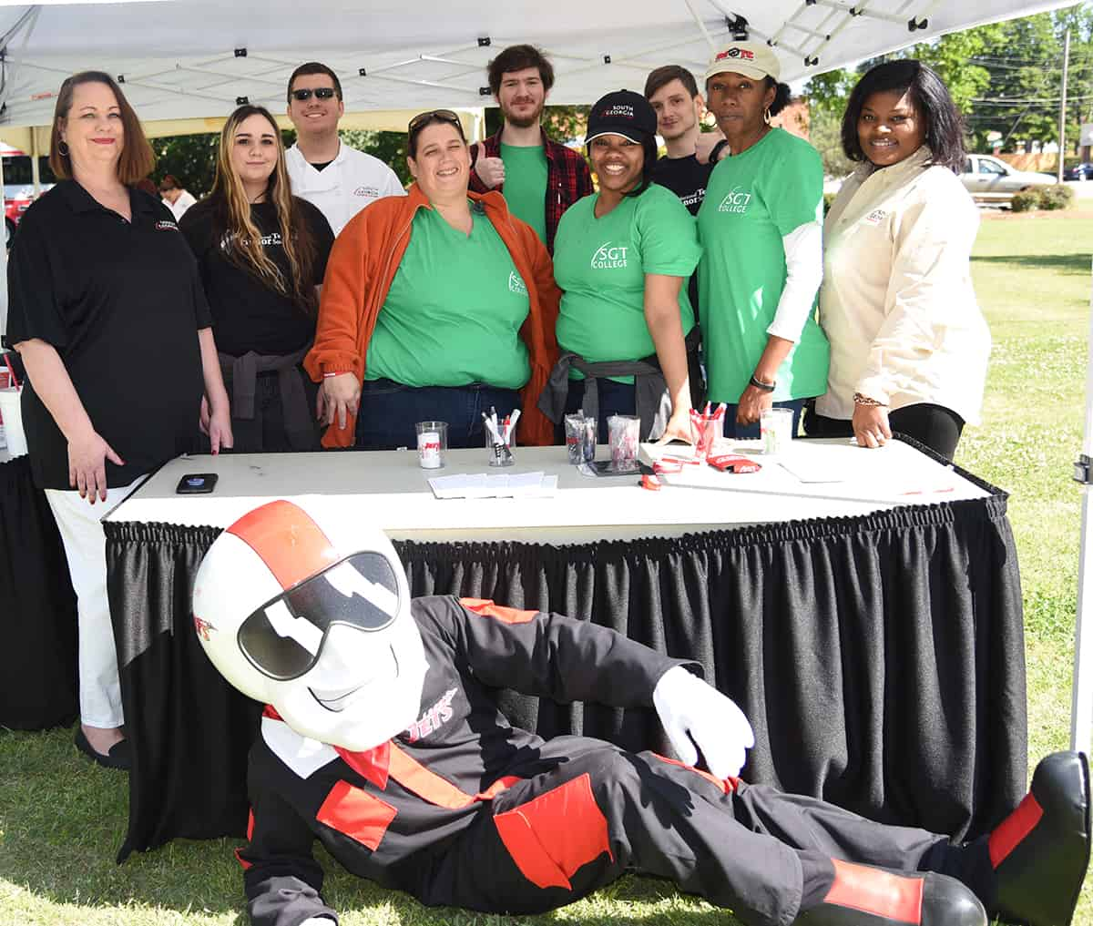 South Georgia Technical College Admissions Coordinator Kari Bodrey and English Instructor Katrice Taylor are shown above with some of the National Technical Honor Society students who helped with the Spring Take Off event.  SGTC's mascot, ACE is also shown with the group.