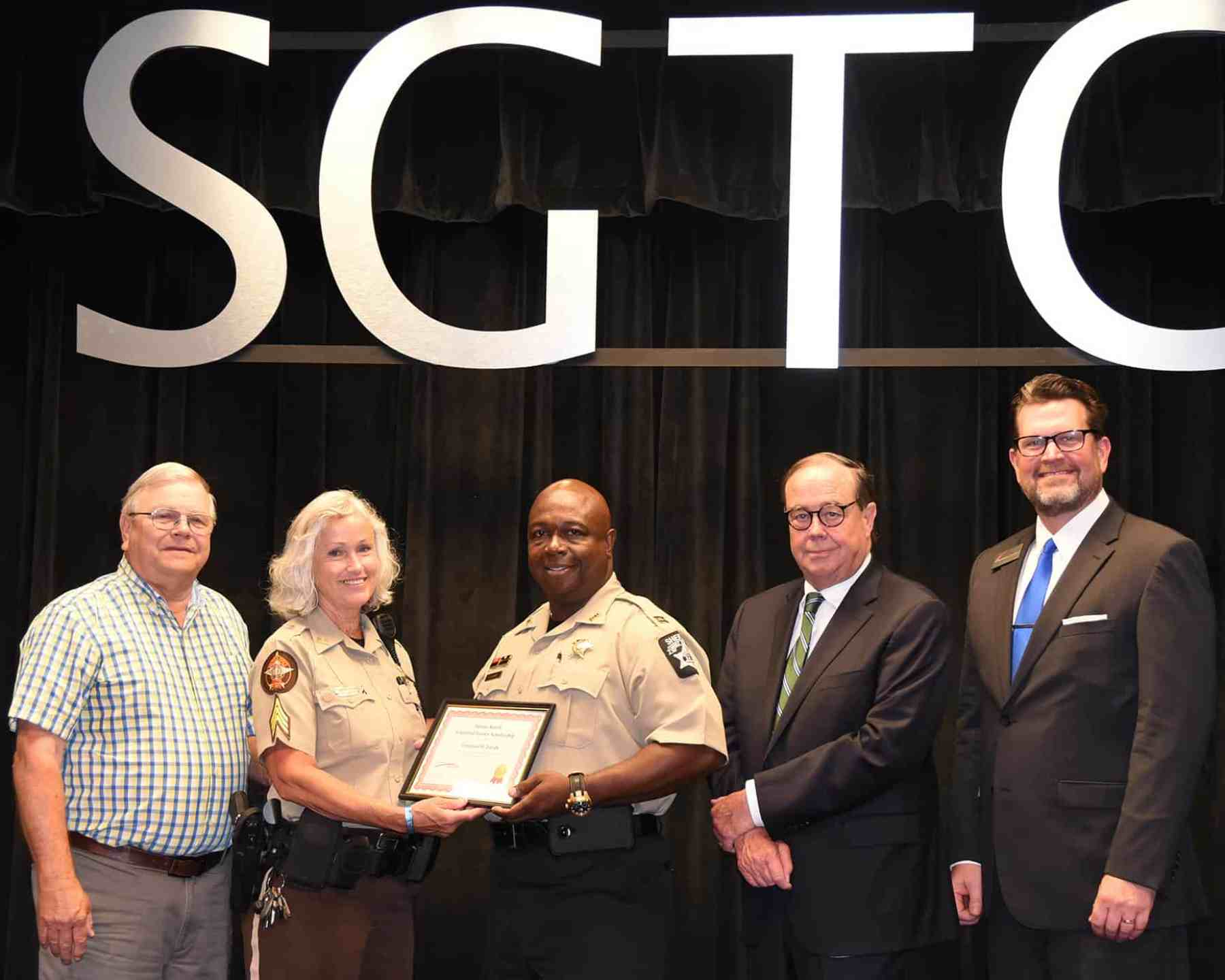 Paul and Sharon Smith Johnson are shown above presenting Dooly County Sheriff Office Captain Emerson R. Lundy with the Smarr-Smith Criminal Justice Scholarship. SGTC Foundation Trustee and retired Judge George Peagler and SGTC President Dr. John Watford are also shown.