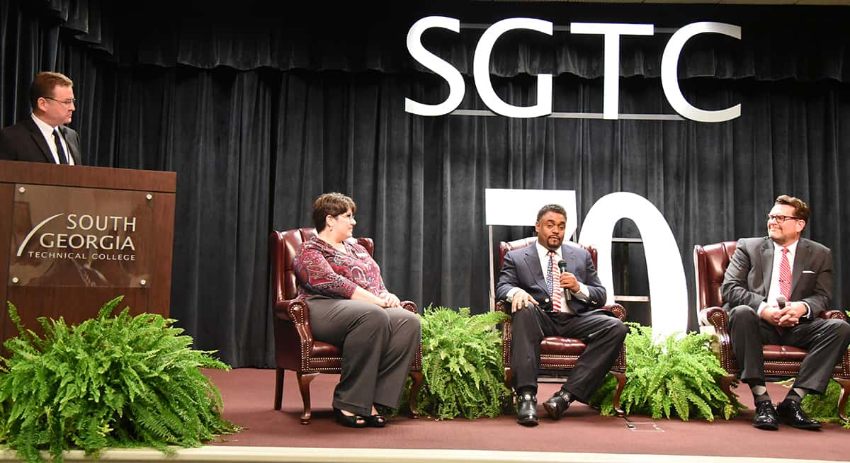 Don Porter, moderator, is shown above asking questions of panelists Dr. Elizabeth Kuipers, Dr. Torrance Choates, and Dr. John Watford.