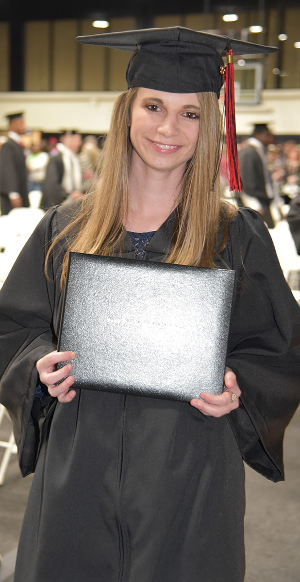 Alyssa Turner from Schley County is shown above after graduating from the licensed practical nursing program and receiving her SGTC diploma.