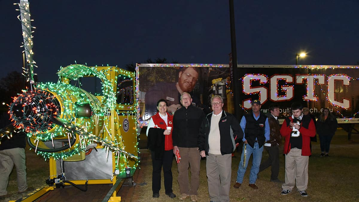 Members of the South Georgia Technical College Aviation Maintenance faculty are shown above with one of the college's aviation trainers displayed in lights.