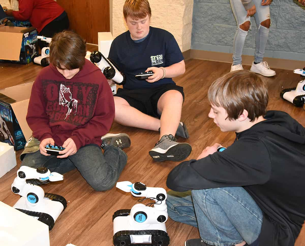 Students learned to program and use robotic arms to pick up items.