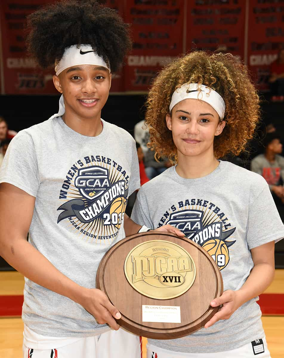 Sophomores Ricka Jackson and Alyssa Nieves are shown holding the Region XVII trophy they worked hard to help the Lady Jets achieve.