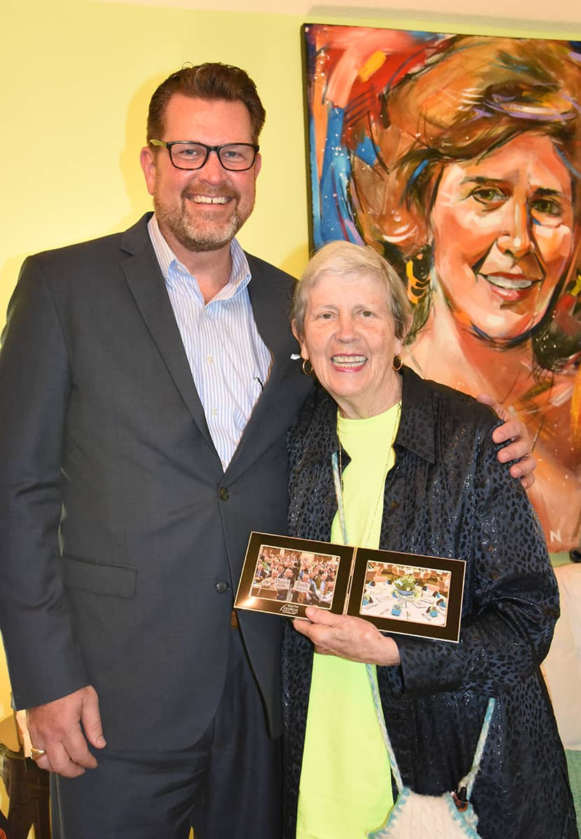 South Georgia Technical College President Dr. John Watford is shown above presenting Ruth Jones with a framed photo of the SGTC Foundation donors thanking her for her time and talent to decorate for this community event each year.